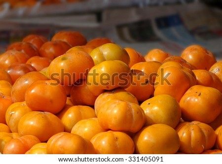 Bright orange persimmons are a popular autumn fruit in Taiwan - stock photo
