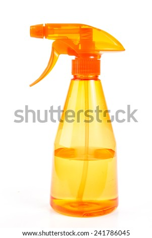 Bright orange spray bottle partially filled with water against white background. - stock photo