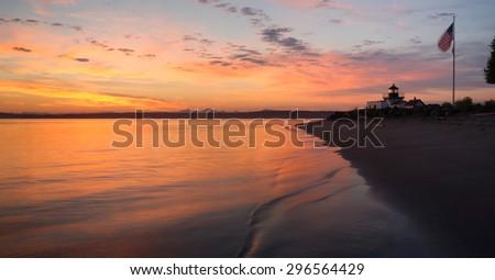 Bright Orange Sunrise Puget Sound Point No Point Lighthouse - stock photo