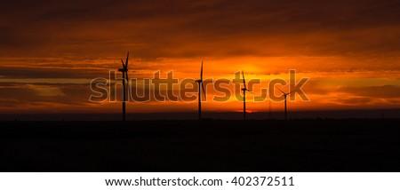Bright Orange Sunrise Signal Peak Wind Turbines Washington Green Energy - stock photo