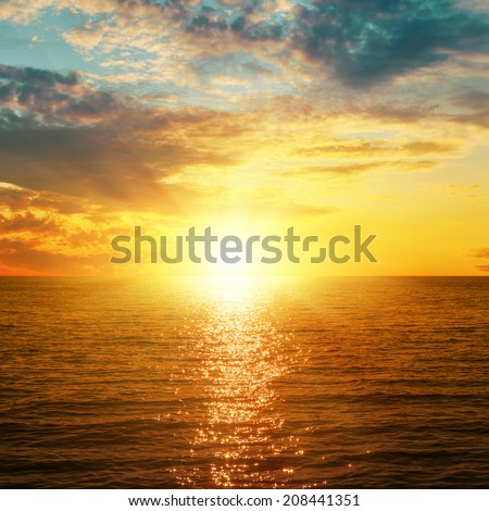 bright orange sunset over sea - stock photo