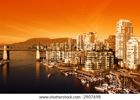 Bright Orange Sunset over the city of Vancouver - stock photo