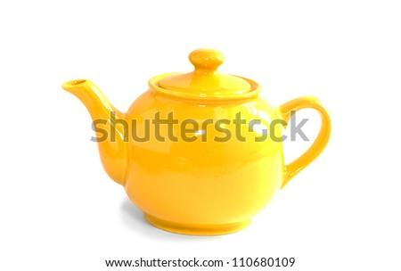 Bright orange teapot isolated on white background - stock photo