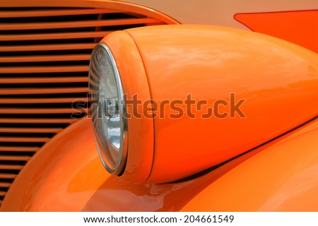 Bright Orange tear drop shape of an antique restored automobile - stock photo