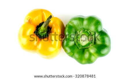 Bright organic peppers isolated on white - stock photo