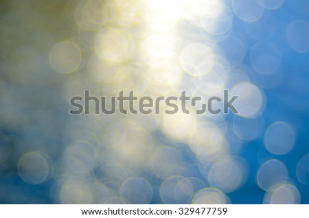 Bright out of focus colorful water and sun reflection true bokeh blurred background. - stock photo