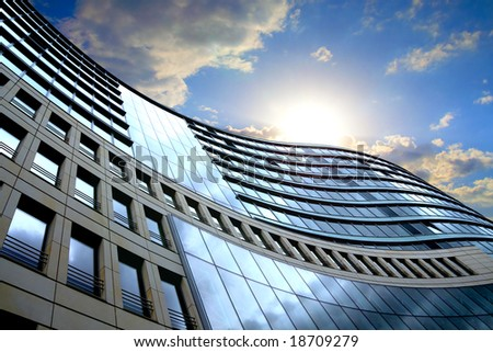 Bright outlook for business. Modern office block with sunny beautiful sky.