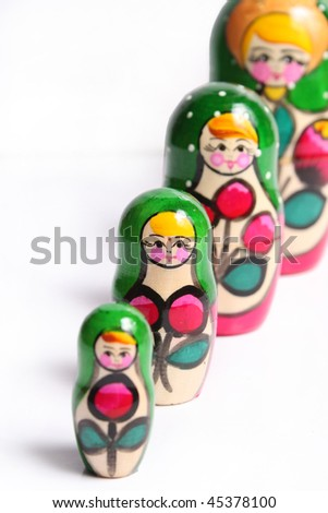 Bright painted nested dolls on white background
