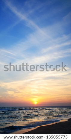 Bright paniramic sunset sky under the sea - stock photo