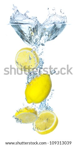 Bright parts of lemon and water splash. Tasty and healthy food