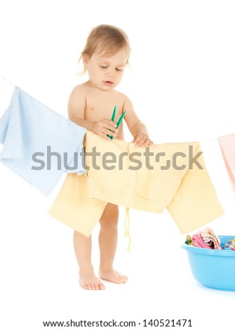 bright picture of adorable baby doing laundry .