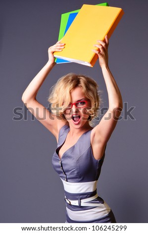 bright picture of angry businesswoman with folders. on a gray background
