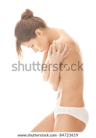 bright picture of beautiful topless woman in panties - stock photo