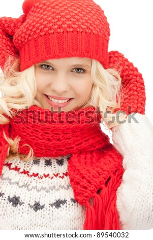 bright picture of beautiful woman in hat, muffler and mittens - stock photo