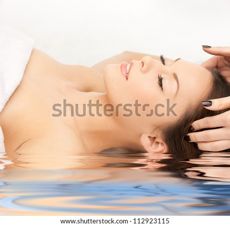 bright picture of beautiful woman in water - stock photo