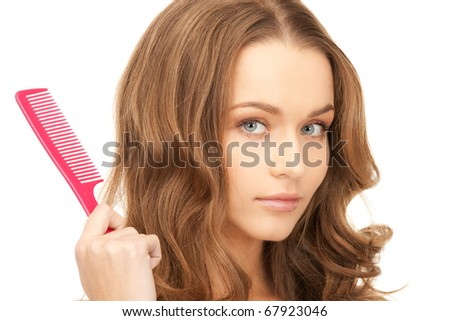 bright picture of beautiful woman with comb - stock photo