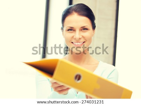 bright picture of beautiful woman with folder - stock photo