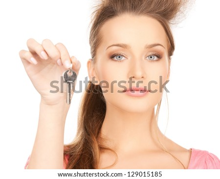 bright picture of beautiful woman with key - stock photo