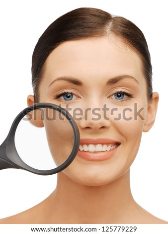 bright picture of beautiful woman with magnifying glass