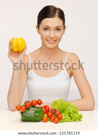 bright picture of beautiful woman with vegetables - stock photo