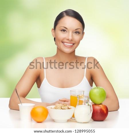 bright picture of beautiful woman with yogurt - stock photo