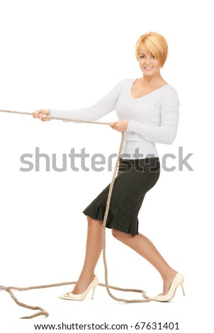 bright picture of business woman pulling rope - stock photo