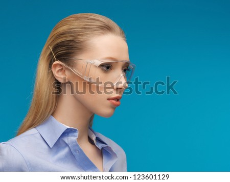 bright picture of businesswoman in protective glasses