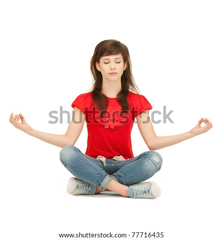 bright picture of calm attractive teenage girl in lotus pose - stock photo