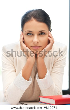 bright picture of calm woman with book