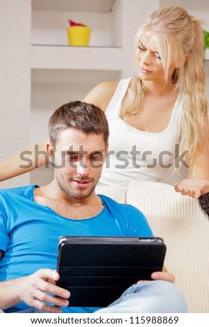 bright picture of couple with tablet PC