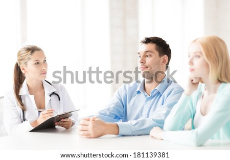 bright picture of doctor with patients in cabinet - stock photo