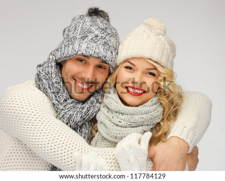 bright picture of family couple in a winter clothes - stock photo