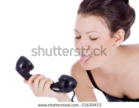 Bright picture of fun brunette showing tongue to phone - stock photo