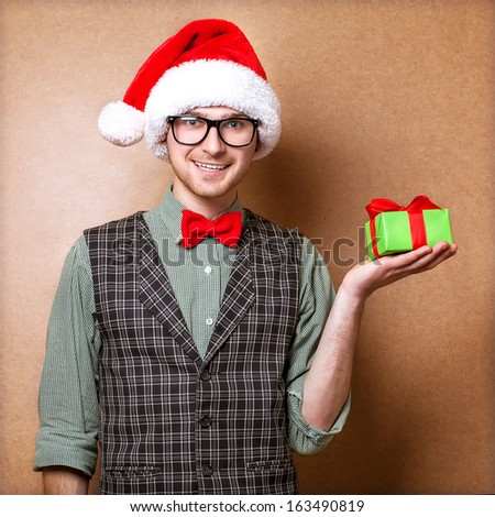 bright picture of handsome man holding  gift boxes - stock photo