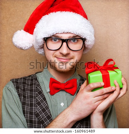 bright picture of handsome man with a gift  - stock photo