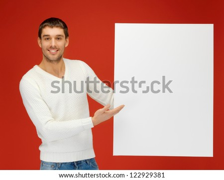 bright picture of handsome man with big blank board. - stock photo