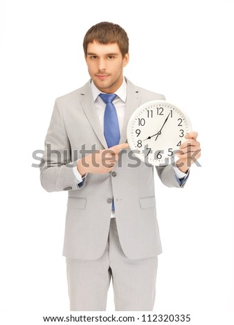 bright picture of handsome man with clock..... - stock photo