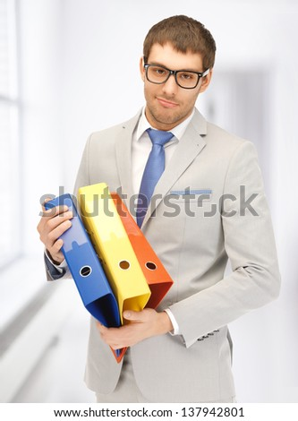 bright picture of handsome man with folders - stock photo