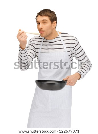 bright picture of handsome man with pan and spoon - stock photo