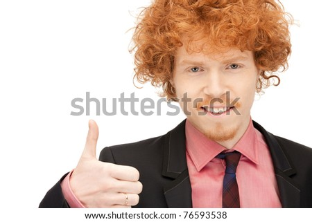 bright picture of handsome man with thumbs up - stock photo