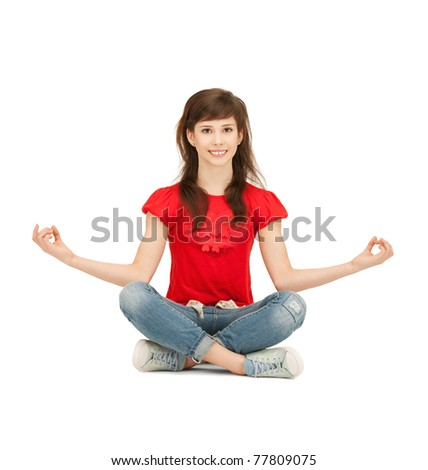 bright picture of happy and carefree teenage girl in lotus pose
