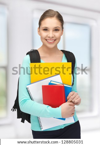 bright picture of happy and smiling teenage girl - stock photo