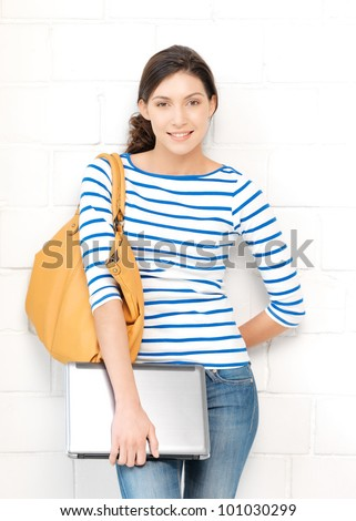 bright picture of happy and smiling teenage girl with laptop - stock photo