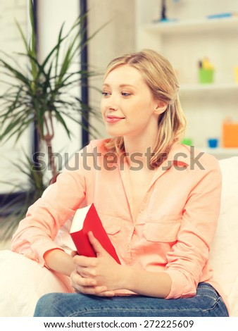 bright picture of happy and smiling woman with book.. - stock photo