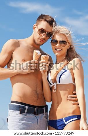 bright picture of happy couple with ice cream. - stock photo