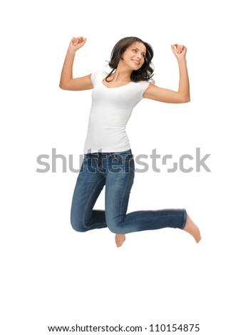 bright picture of happy jumping woman in blank white t-shirt. - stock photo