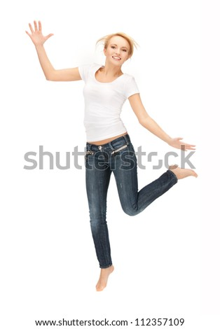 bright picture of happy jumping woman in blank white t-shirt.