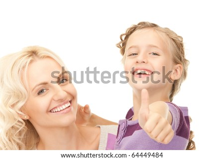 bright picture of happy mother and child (focus on girl) - stock photo