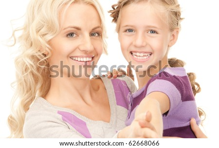bright picture of happy mother and child (focus on woman)