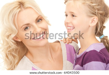 bright picture of happy mother and child (focus on woman) - stock photo